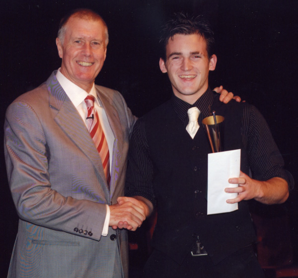 Sir Geoff Hurst presents HGTA Apprentice if the year Michael Wilkins of Moorfields FC with his award